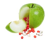 Apple with vitamin capsules Royalty Free Stock Images