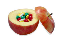 Apple and vitamins Royalty Free Stock Photography