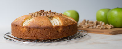 Apple and Walnut Cake, Three Apples and Walnut Pieces. Stock Photos