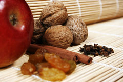 Apple, walnuts, cinnamon, berries and cloves Royalty Free Stock Images