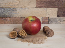 Apple and walnuts Royalty Free Stock Photo
