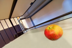 Apple in warehouse. Alone apple in a big empty warehouse Royalty Free Stock Photo