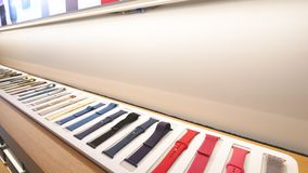 Apple Watch bands Apple Store Champs-Elysees iconic store Paris. Paris, France - Circa 2019: Apple Watch bands collection products are displayed inside the new stock footage