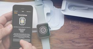 Apple watch settings time-lapse flare fast motion. PARIS, FRANCE - CIRCA 2018: POV man unboxing unpacking latest Apple Watch Series 3 GPS LTE smartwatch wearable stock video footage