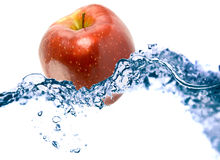 Apple in a water. On a white background Royalty Free Stock Image