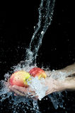Apple and water Stock Images