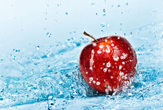 Apple and water stock photo