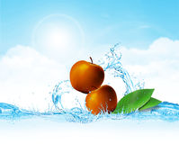 Apple in Water. Fresh Apples and leaves falling in cool water which creates splash Royalty Free Stock Images