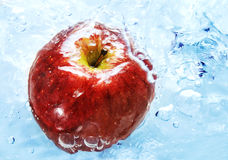 Apple in a water Stock Photo