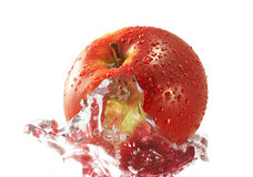 Apple in water. Red apple in water. Isolated over white background Royalty Free Stock Photography