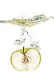 Apple in water royalty free stock photo