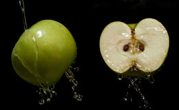 Apple with water droplets Royalty Free Stock Image