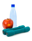 Apple, water and dumbbells Stock Image