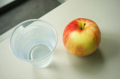 Apple and water Royalty Free Stock Photos