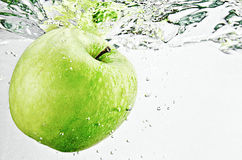 Apple in water. Green apple in the water stock image