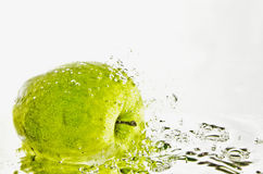 Apple in water. Green apple in the water stock photo