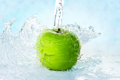 Apple and water Stock Photography