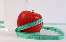 Apple,water and measurement Stock Photos