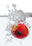 Apple in water splash Royalty Free Stock Photos