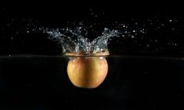 Apple water splash Royalty Free Stock Image