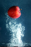 Apple with water splash Stock Photos