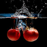 Apple water splash stock images