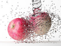 Apple with water splash Royalty Free Stock Photos