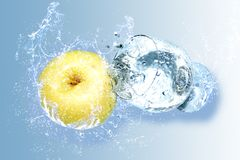 Apple and water splashes Royalty Free Stock Photography