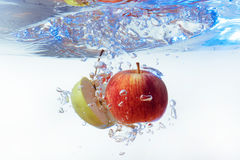 Apple in water on a white background Stock Photography