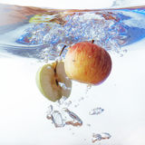 Apple in water on a white background Royalty Free Stock Photo