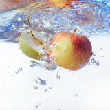 Apple in water on a white background Royalty Free Stock Images