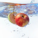 Apple in water on a white background Royalty Free Stock Photos