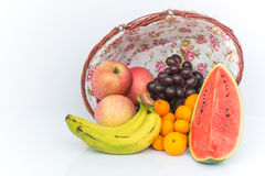 Apple, Watermelon, Orange, Grape and Banana are Fruits cool effe. Cts on wooden basket background Stock Photos