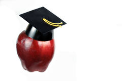 Apple wearing graduation cap. Stock Images