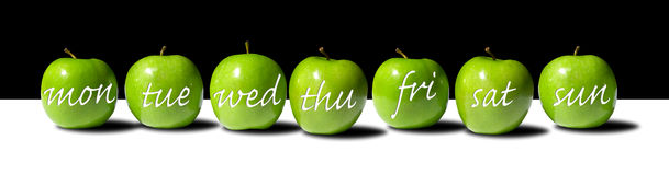 Apple a (Week)Day. A Row of Green Apples Bearing the Days of the Week in a White Script Font Royalty Free Stock Image