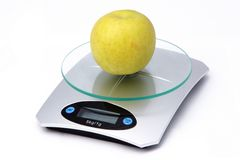 Apple on weighing machine. Isolated on white background Stock Image
