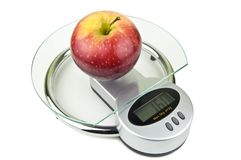 Apple on weight Stock Photography