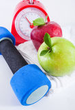 Apple and weights with measuring tape. Dumbells with measuring tape and apples royalty free stock photo