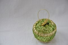 A toy green with gold sparkle ornament apple Stock Image