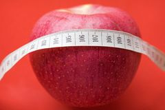 Apple with White Measuring Tape Stock Photo