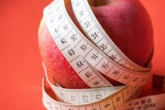 Apple with White Measuring Tape Royalty Free Stock Images