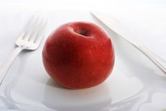Apple on the plate. Royalty Free Stock Image