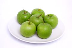 Apple in white plate Royalty Free Stock Photos