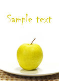 Apple on the white plate isolated Royalty Free Stock Image