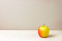 Apple on white wooden table Royalty Free Stock Photography