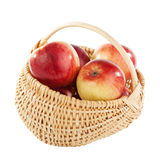 Apple in wicker basket isolated in white Stock Photos