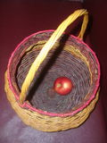 Apple in a wicker basket Stock Photos