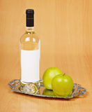 Apple wine in closed bottle on tray Stock Photography