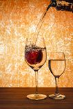 An Apple in wine glass with a water splash. stock image