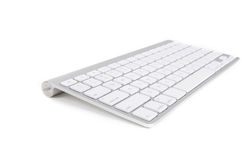 Apple wireless keyboard. A wireless computer keyboard from Apple for Mac and Macbooks, isolated on white background Royalty Free Stock Photography
